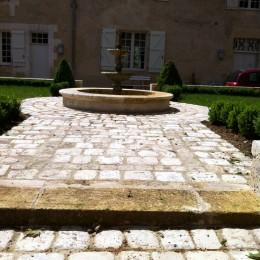 Restauration de margelles de fontaine et du pavage